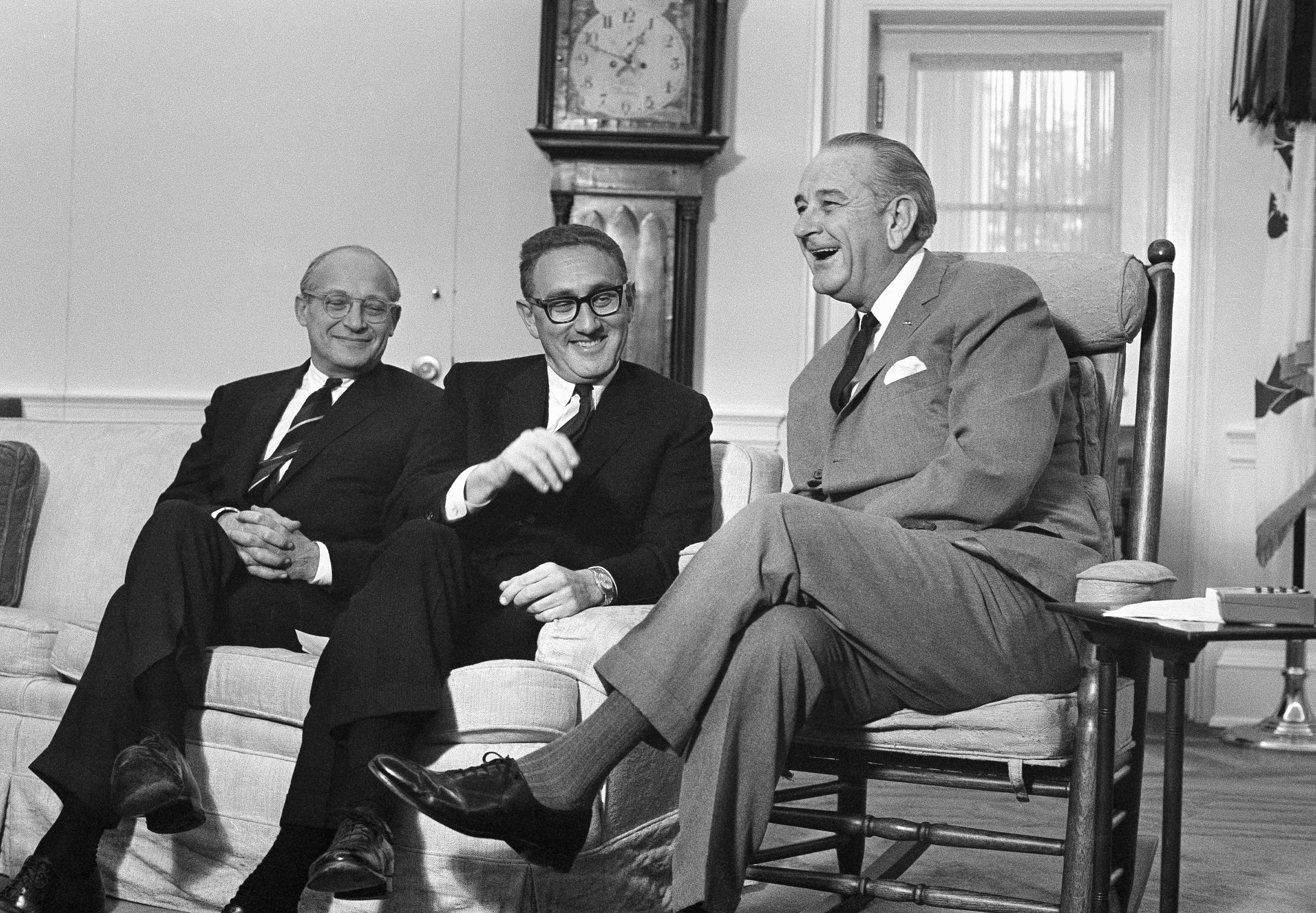 Kissinger confers with President Lyndon Johnson not long after being appointed to Richard Nixon's national-security team. December 5, 1968. (Associated Press)