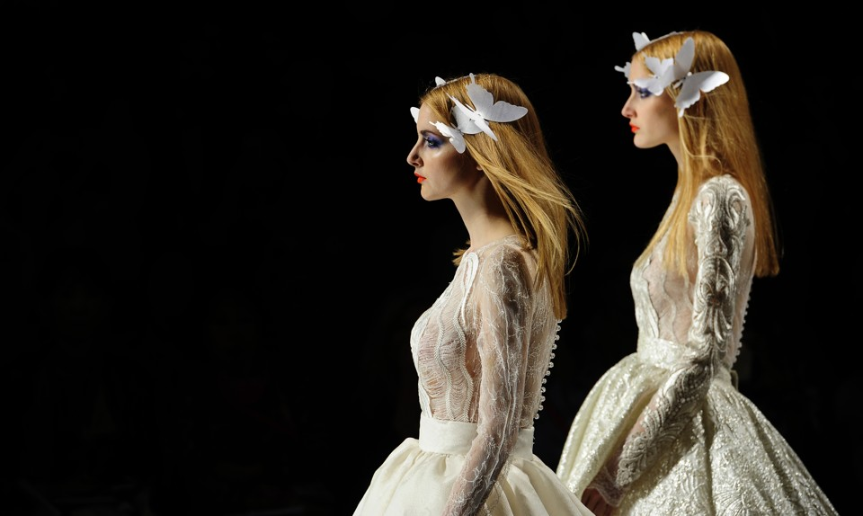 Models wear creations from yolan cris during barcelona bridal fashion