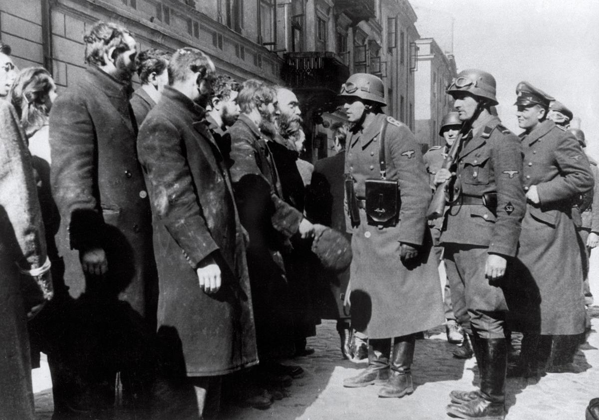 German soldiers question Jews after the Warsaw Ghetto Uprising in 1943. In October 1940, the Germans began to concentrate Poland's population of over 3 million Jews into overcrowded ghettos. In the largest of these, the Warsaw Ghetto, thousands of Jews died due to rampant disease and starvation, even before the Nazis began their massive deportations from the ghetto to the Treblinka extermination camp. The Warsaw Ghetto Uprising -- the first urban mass rebellion against the Nazi occupation of Europe -- took place from April 19 until May 16 1943, and began after German troops and police entered the ghetto to deport its surviving inhabitants. It ended when the poorly-armed and supplied resistance was crushed by German troops. #  OFF/AFP/Getty Images
