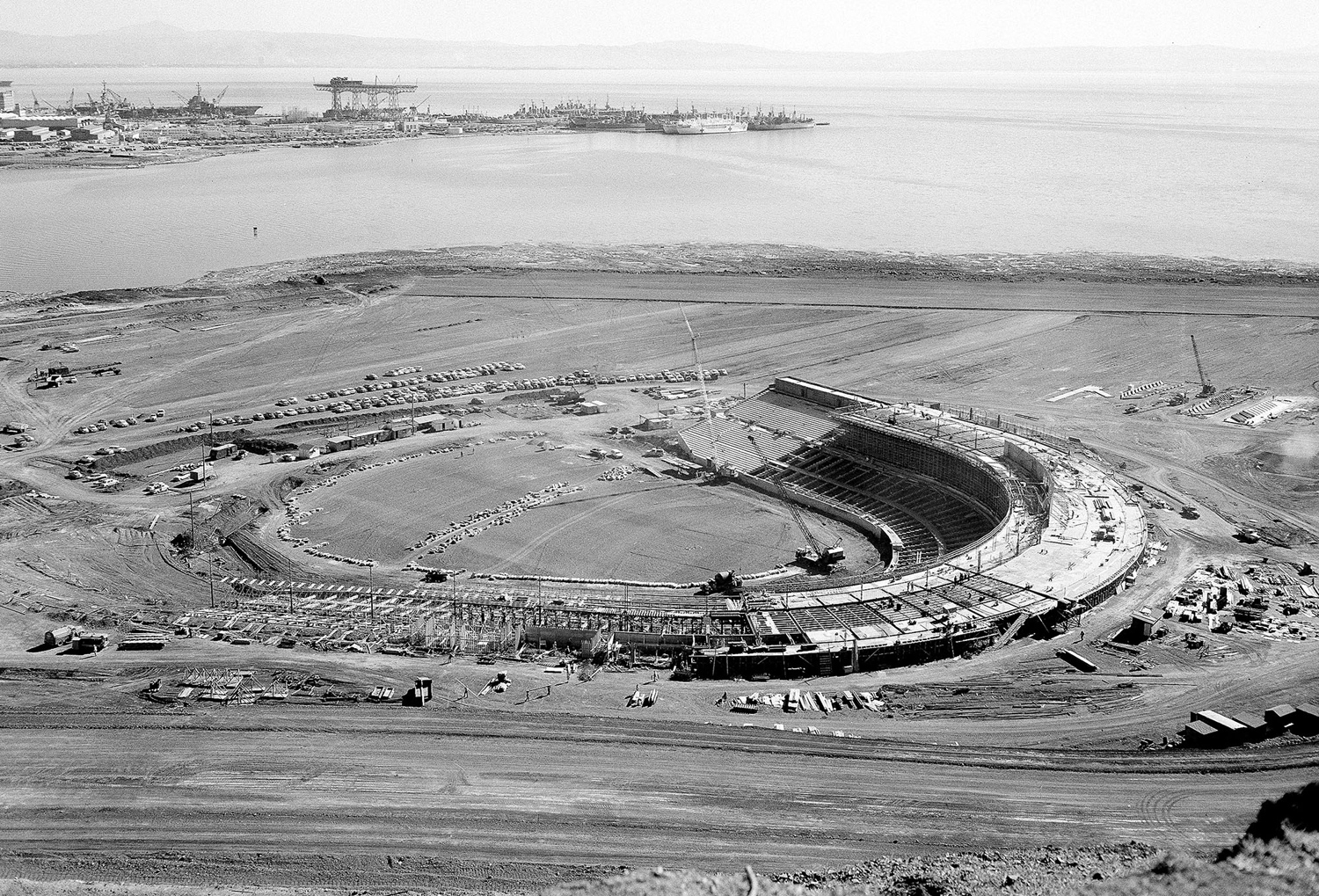 The 45,000-seat stadium being built for the San Francisco Giants, photographed on March 4, 1959. In the background is the U.S. Naval Shipyard at Hunter's Point.