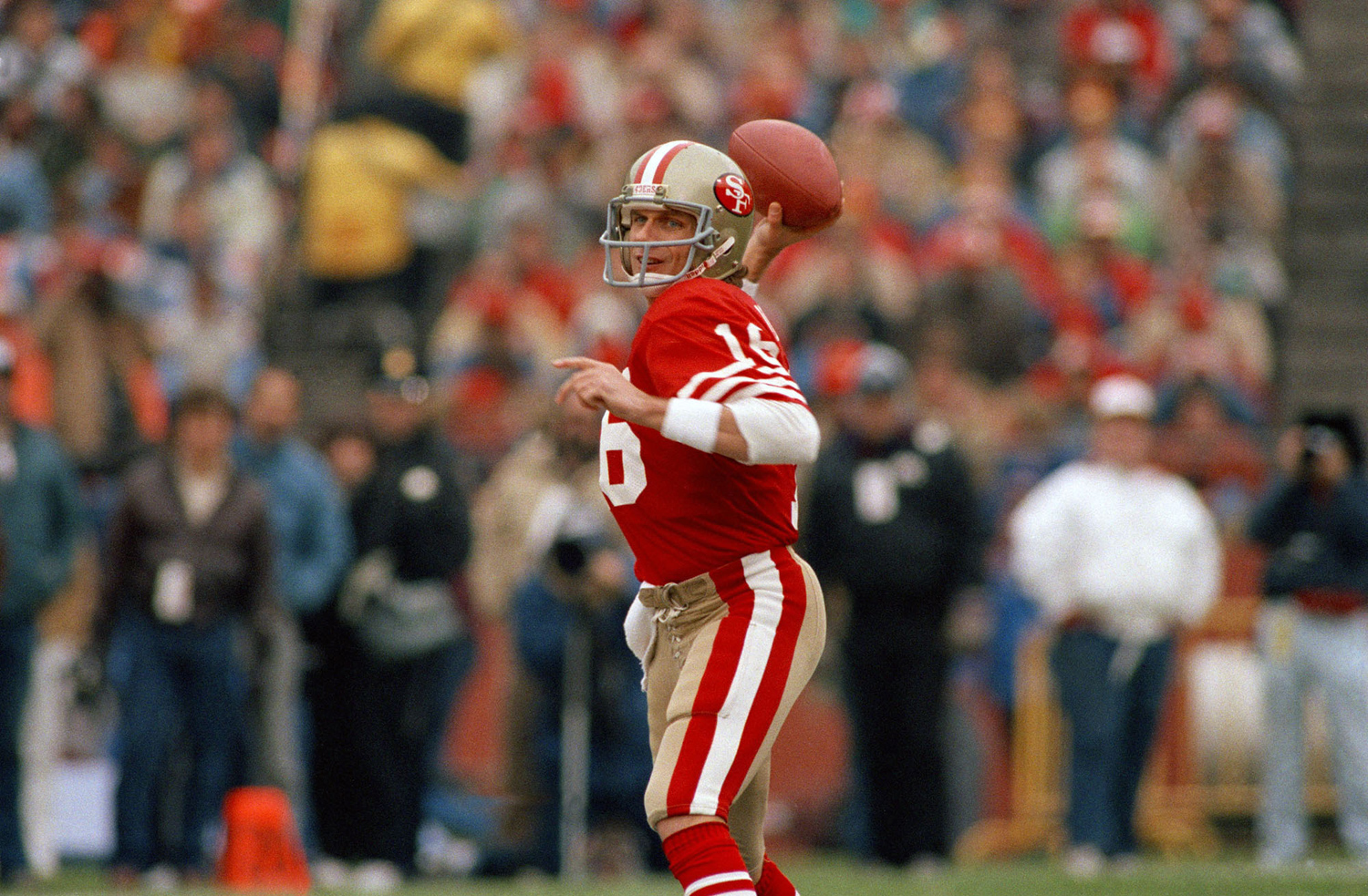 San Francisco 49ers quarterback Joe Montana drops back to fire off a pass against the New York Giants during the first half of their NFC playoff game in Candlestick Park on December 29, 1984. Montana threw three touchdown passes to lead the 49ers to a 21-10 win over the Giants.