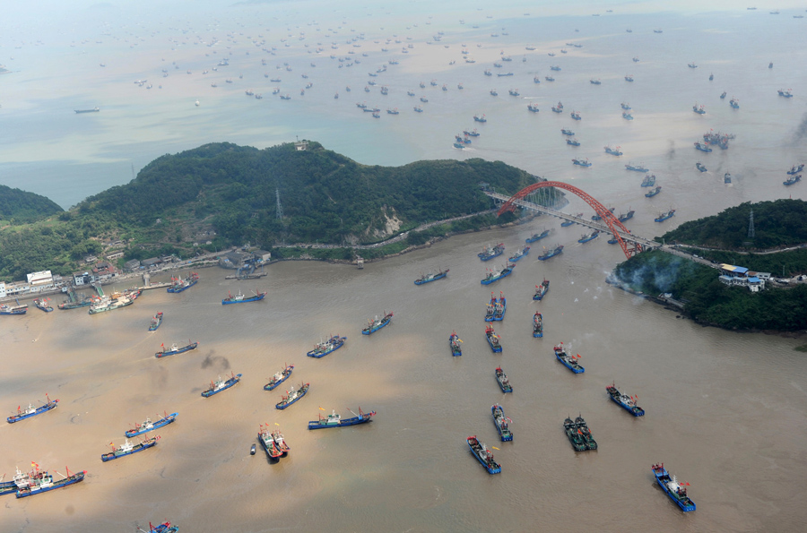 Boats set out from a port as the seasonal fishing ban ends in Ningbo, Zhejiang Province, on September 16, 2015
