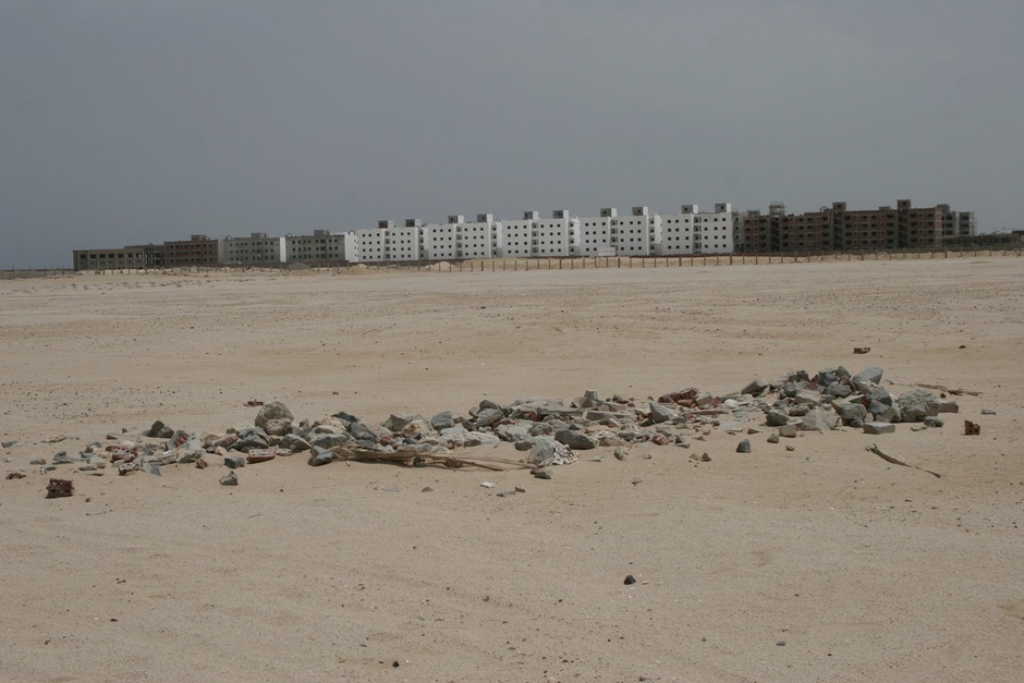 http://www.citylab.com/housing/2015/01/fighting-a-housing-crisis-egypt-builds-towers-in-the-desert/384728/