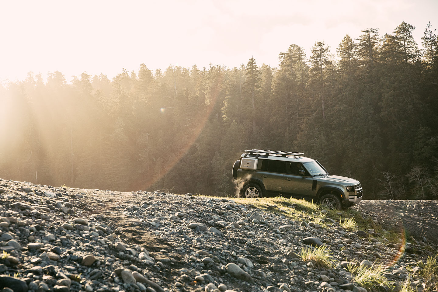 The new Land Rover Defender 110 off-roading in Jedediah Smith Redwoods State Park in Northern California