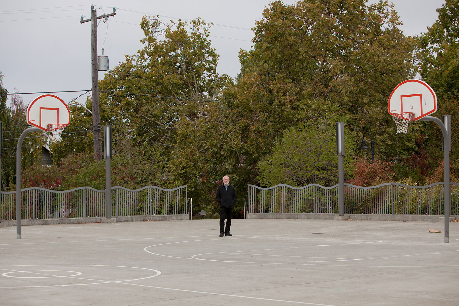Leo Muller, executive director of CHOICES Education Group, on a basketball court
