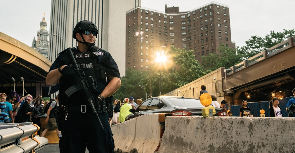 Photograph by Greg Kahn / A member of the NYPD's counterterrorism unit stands guard near the Brooklyn Bridge in New York City, July 4, 2016.
