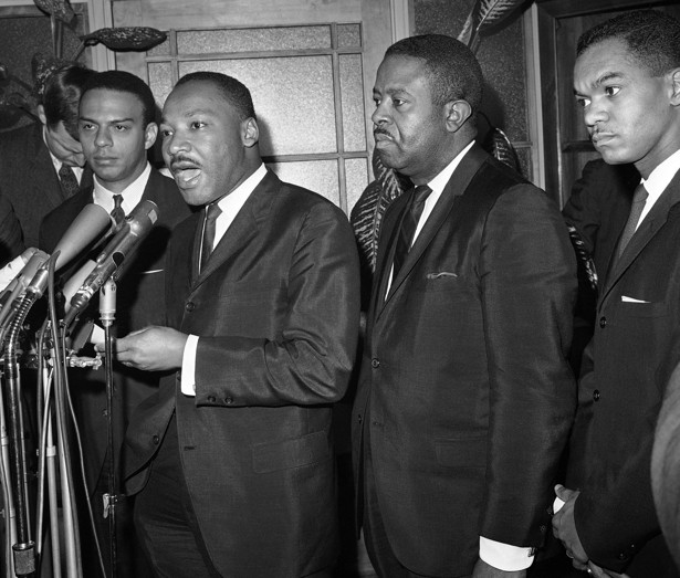 The Rev. Martin Luther King makes a statement at the Justice Department in Washington on Dec. 1, 1964 after a meeting with FBI Director J. Edgar Hoover.