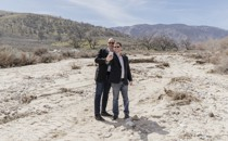 Steven Davidoff Solomon and Frank Partnoy pose for a selfie on the rocky soil of Tejon Ranch