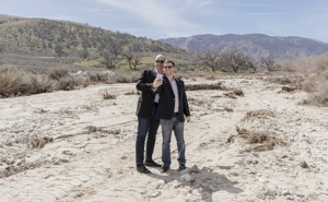 Steven Davidoff Solomon and Frank Partnoy pose for a selfie on the rocky soil of Tejon Ranch