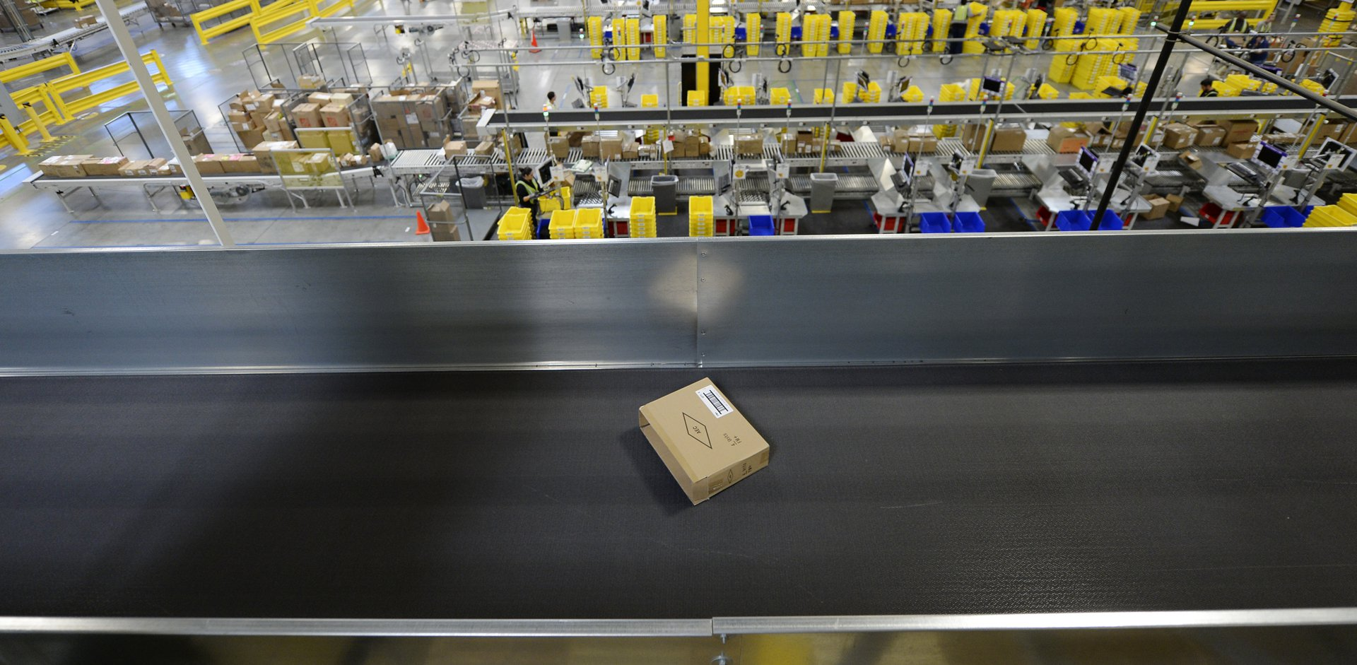 A cardboard box on a conveyor belt