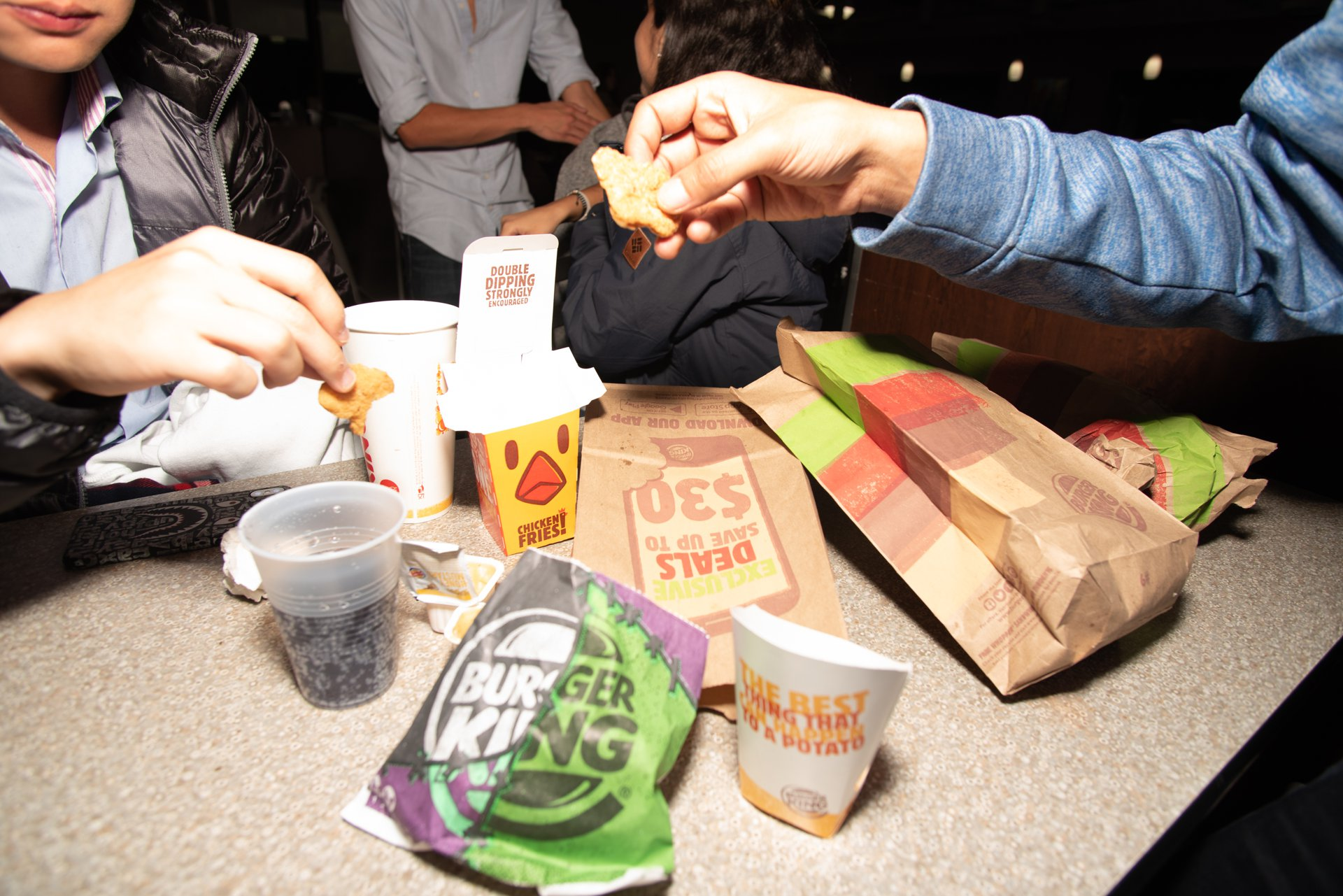 Students share late-night French fries at the Burger King near Northwestern University.