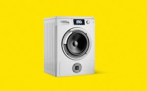 Illustration: washing machine with speaker on yellow background