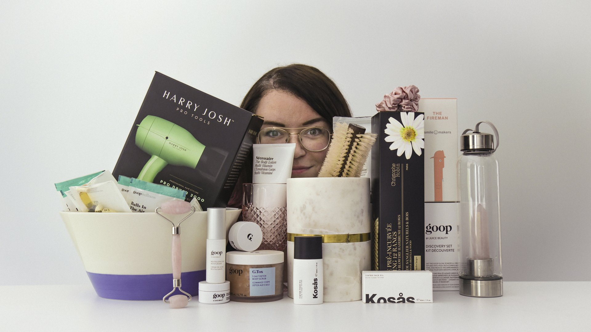 The writer's face, partially obscured by $1,279 of Goop products.