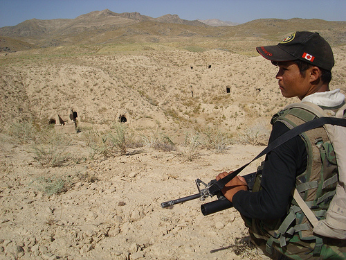 Afghan National Army soldiers look out over cave-clearing operations