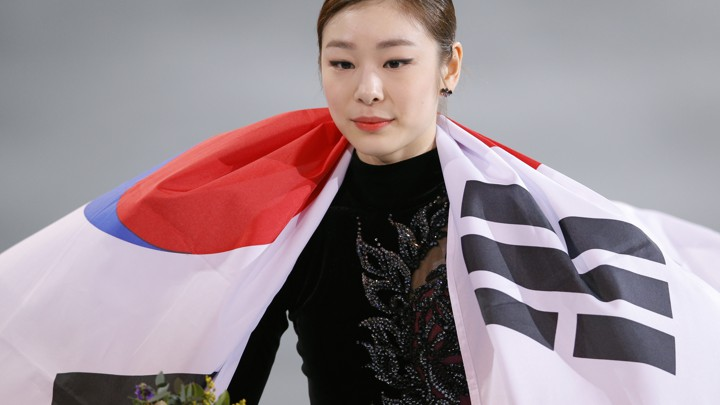 311491d7c Kim Yuna with the South Korean flag after winning second place in women's  figure skating at the Sochi OlympicsVadim Ghirda/AP