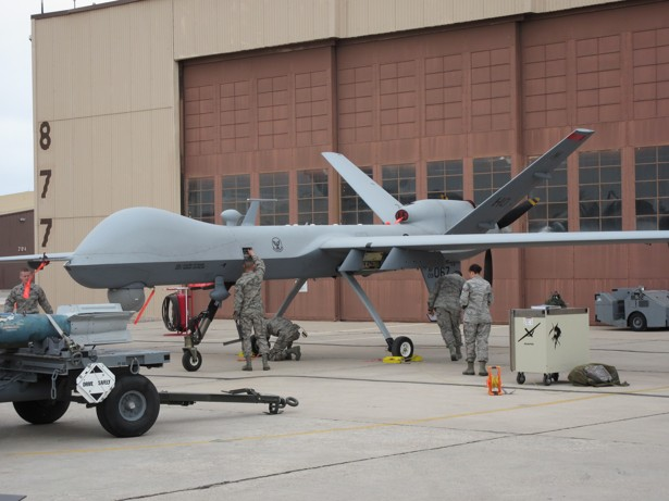A Missile Is Loaded Onto Predator Drone During Weapons Loading Competition At Holloman Air Force Base Corey Mead