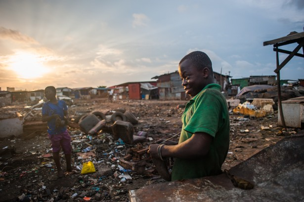 Kwesi Bido (right) and Inusa Mohammed spend evenings and weekends searching  for scrap at Agbogbloshie, an electronic waste dump in Accra, Ghana.