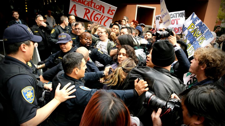 What is the real role of police on college campuses the atlantic university of california police control a crowd of students protesting tuition increasesic risberg ap ccuart Images