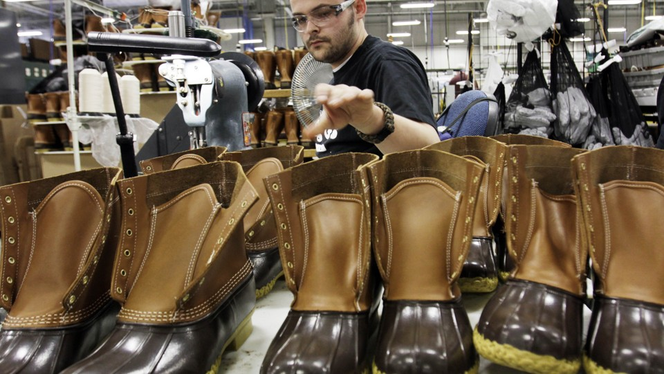 Eric Rego stitches boots in the facility where L.L. Bean boots are  assembled in Brunswick, Maine, in 2011. Pat Wellenbach / AP
