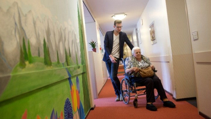 Jurriën Mentink Helps One Of His Neighbors At Residential And Care Center  Humanitas In Deventer, The Netherlands.Humanitas