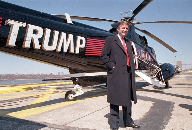 Donald Trump poses in front of a helicopter at New York Port Authority ...