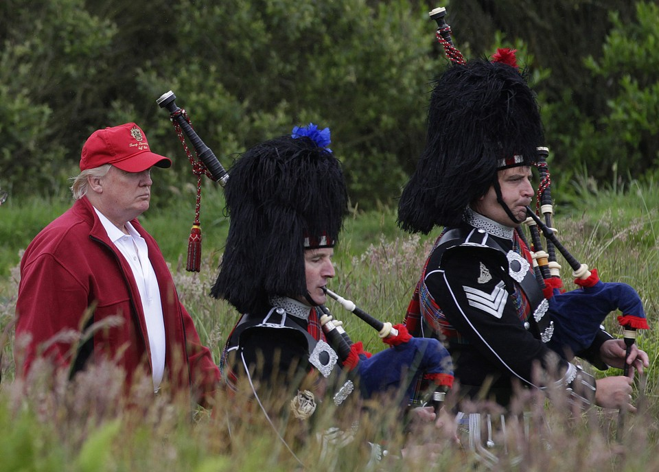 Donald Trump follows bagpipers to the opening of his new golf course ...