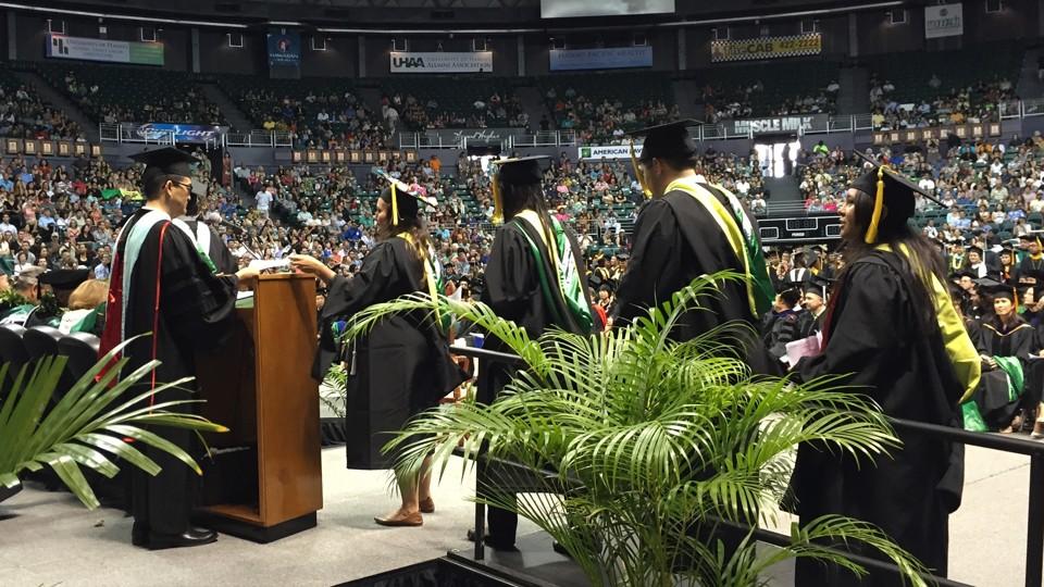 University of Hawaii students receiving their diplomas in 2015 University  of Hawaii / Flickr