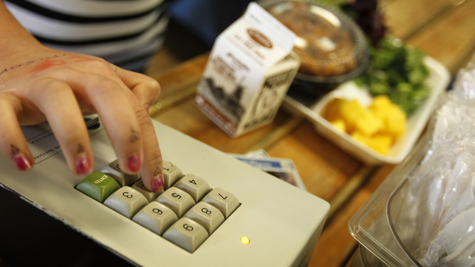 A student keys in her payment code as she orders lunch at Marston Middle  School Mike Blake / Reuters