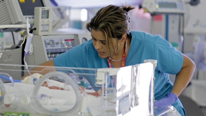 A Nurse Checks On An Infant In The Neonatal Intensive Care Unit Of Holtz Childrens Hospital MiamiJoe Skipper Reuters