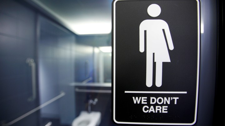 A sign protesting a recent North Carolina law restricting transgender bathroom access is seen in Durham.Jonathan Drake / Reuters