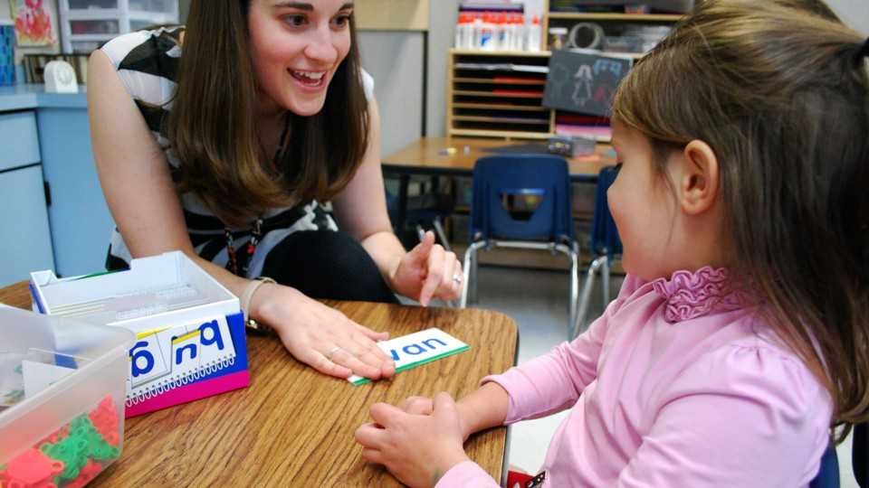 Carrie Giddings works with a student on her sight words during the last  week of school at Kruse Elementary School in Colorado Lillian Mongeau / The  ...
