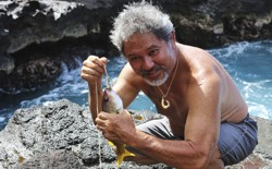 Umi Kai uses a traditional Hawaiian hook to catch a fish at the Papahanaumokuakea Marine National Monument in Hawaii in 2015.