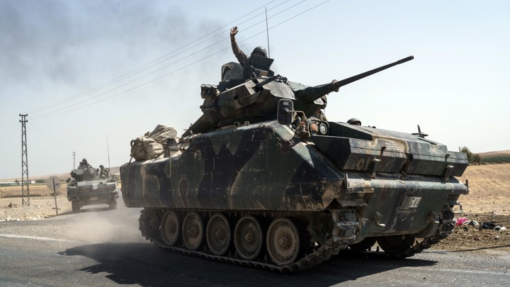 Turkish troops head to the Syrian border, in Karkamis, Turkey, on August 27.