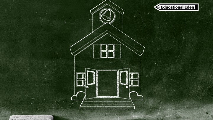 A Green Chalkboard With A Sketch Of An Old Fashioned Schoolhouse As Well As  Chalk