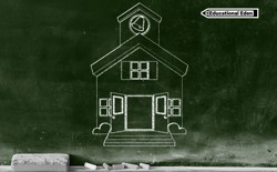 A green chalkboard with a sketch of an old-fashioned schoolhouse as well as chalk and an eraser