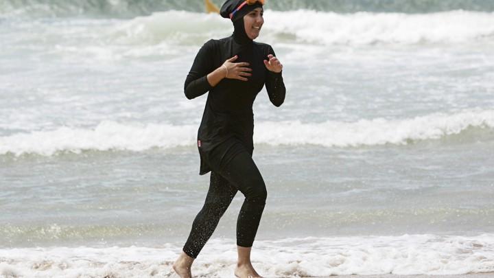 977c3d0d70d35 A volunteer lifeguard wearing a Burqini in Sydney, Australia.Tim Wimborne /  Reuters