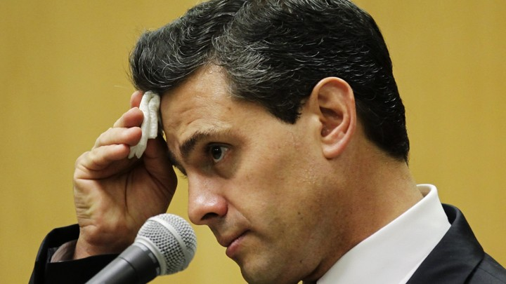Pena Nieto, presidential candidate for the PRI, listens during a news conference in Mexico City in 2012.