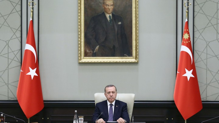 Turkish President Recep Tayyip Erdogan chairs a Cabinet meeting Monday, seated under a portrait of Mustafa Kemal Ataturk, the founder of modern Turkey.