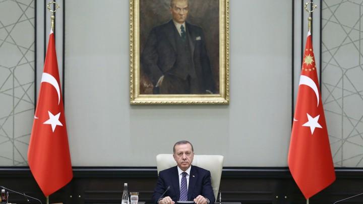 Turkish President Recep Tayyip Erdogan chairs a Cabinet meeting Monday, seated under a portrait of Mustafa Kemal Ataturk, the founder of modern Turkey.