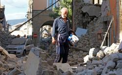 A man walks through rubble following an earthquake in Amatrice.