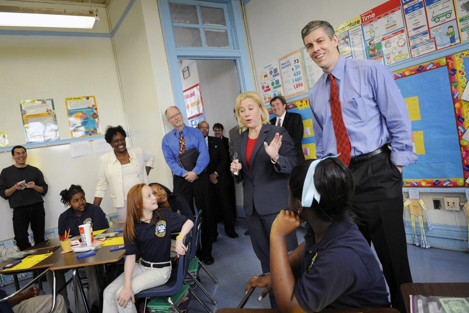 Former U.S. Education Secretary Arne Duncan smiles while meeting with fourth-graders in a New Orleans charter school in 2009.