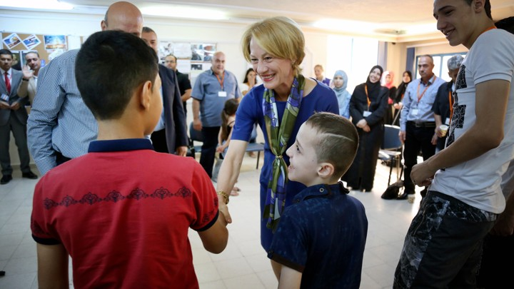 Alice Wells, the U.S. Ambassador to Jordan, greets members of the Jouriyeh family before they leave for resettlement in San Diego, California