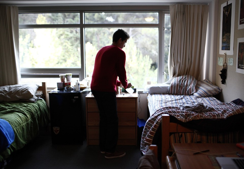 A Student In His College Dorm Room On Campus