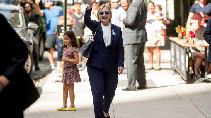 Hillary Clinton leaving her daughter's apartment building on September 11 in New York