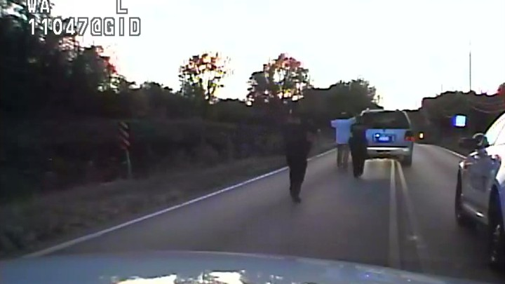 A still from the police video showing Terence Crutcher being approachedby police officers in Tulsa, Oklahoma