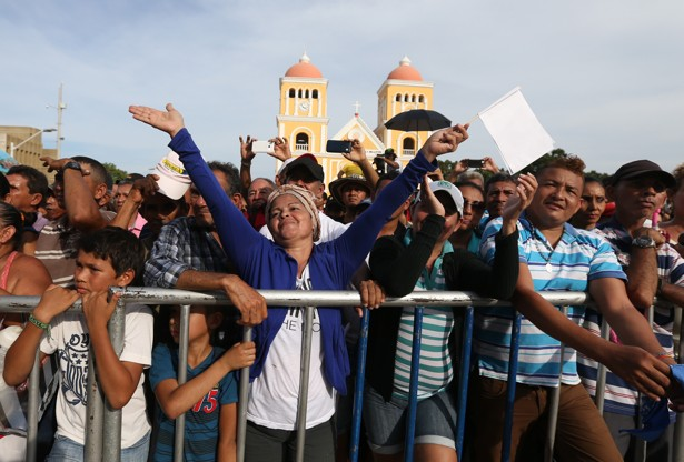 People enjoy a concert for peace in Carmen de Bolivar, Colombia, Sunday, Sept. 25, 2016. Colombia's government and the Revolutionary Armed Forces of Colombia, FARC, will sign a peace agreement to end over 50 years of conflict, in Cartagena, on Monday.