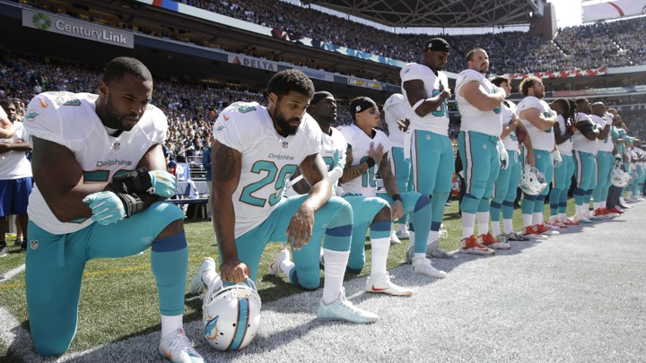 Miami Dolphins players knelt during the playing of the national anthem Sunday
