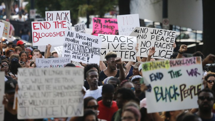 Demonstrators march through downtown Atlanta on July 8 to protest the shootings of black men by police officers.
