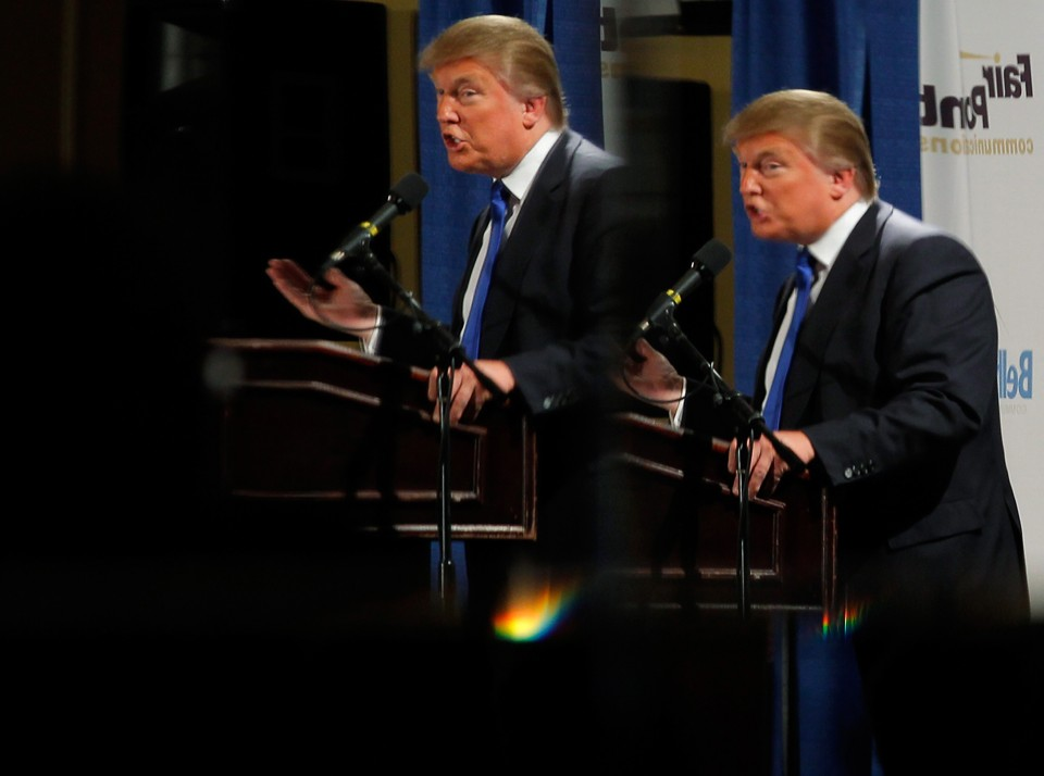 Donald Trump is reflected in mirrors while speaking at the Greater Nashua Chamber of Commerce Expo in 2011.