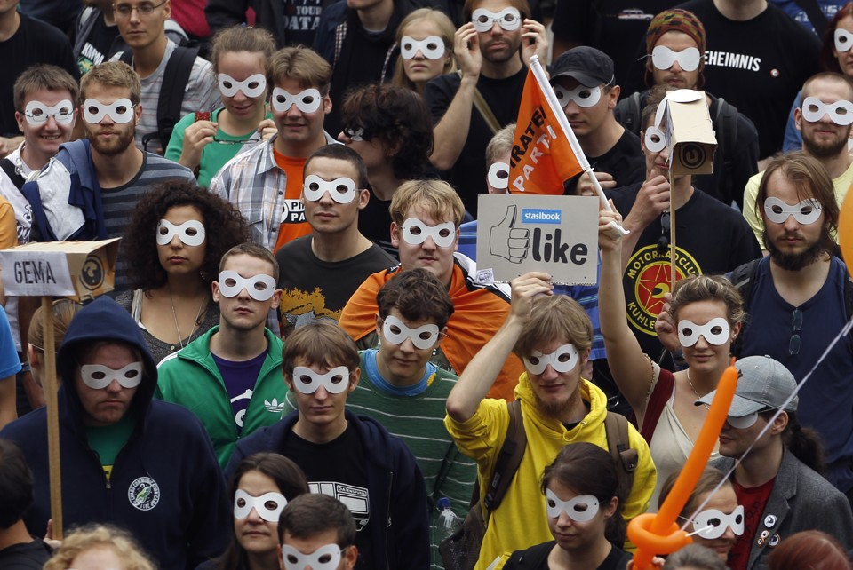 Protestors wearing masks at a rally for digital privacy in Berlin